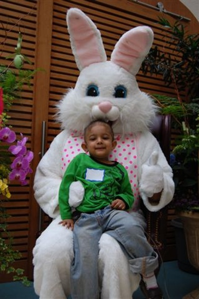 The Easter Bunny spends some time to taking photographs with the children.